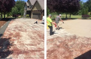 workers restoring concrete driveway